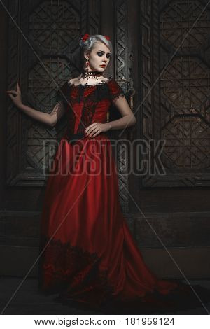 Woman in ball gown with lace Victorian retro style.