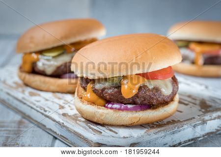 fresh tasty grilled burger cheeseburger on a wooden board