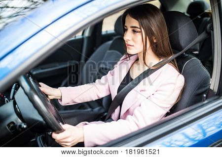 Portrait Of Young Woman With Fasten Seat Belt Drive Her Car