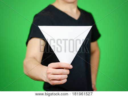 Man Showing Blank White Triangular Flyer Brochure Booklet. Leaflet Presentation. Pamphlet Hold Hands
