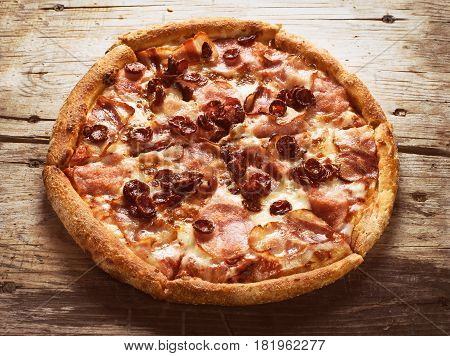 Meat Pizza On A Wooden Background