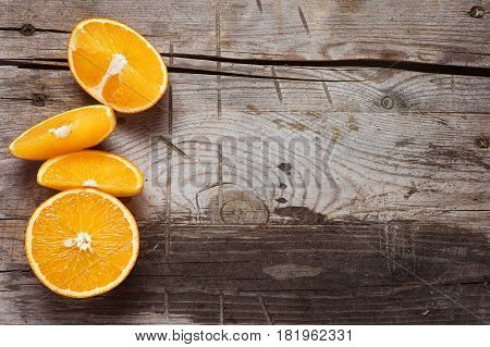 fresh orange fruits on a wooden background. Top view