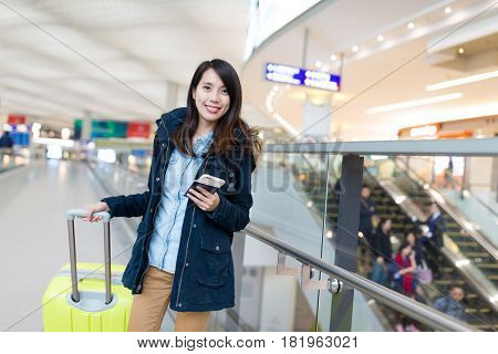 Woman go travel with her luggage at Hong Kong international airport