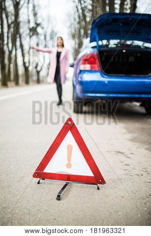 Woman Putting A Triangle On A Road, Car Trouble Trying To Stop And Get Help From Other Driver From R