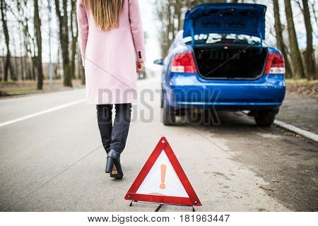 Woman Putting A Triangle On A Road And Back To Brocken Car
