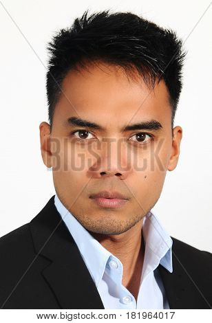 Portrait of a young Filipino onver a white background