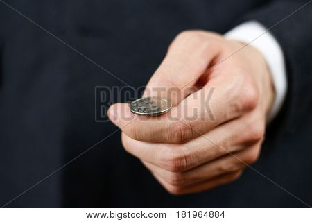 Businessman Tossing A Coin. Heads Or Tails. Close Up