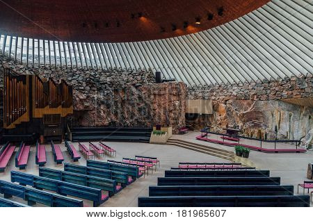 HELSINKI FINLAND - FEBRUARY 26: Interior of the empty Temppeliaukio church. Built directly into solid rock it is also known as the Rock Church.