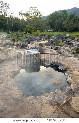 LAMPANG THAILAND - DECEMBER 27 2014: Boiling a basket of eggs inside Jae Sorn hot spring park in Lampang Thailand.