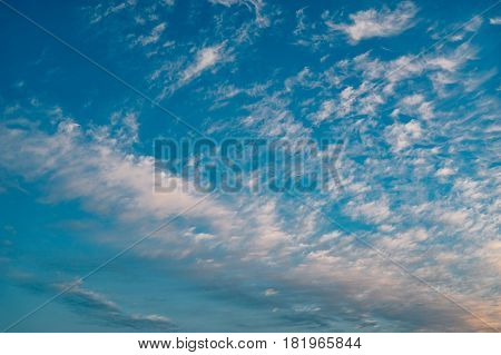 Wonderful altocumulus clouds on deep blue morning sky