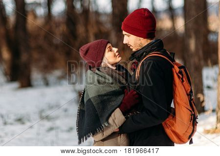 Young Hipster Couple Hugging Each Other In Winter Park.