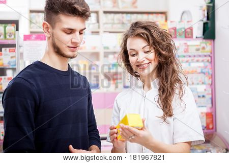 Woman and her client in front of the shop. Healthcare business