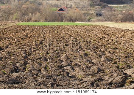 Picture of a plowed agricultural soil in transylvanian countryside