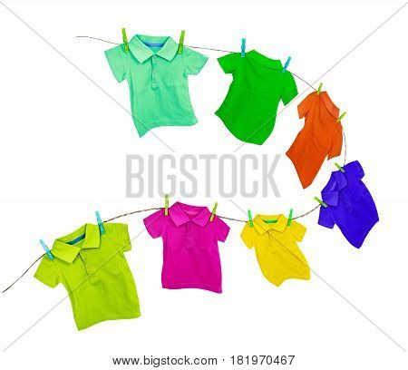 Laundry line with colored t-shirts isolated on a white background