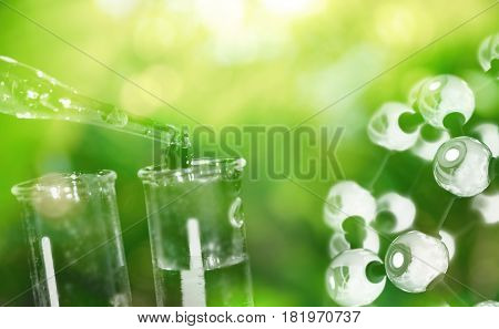test tube and drop of water with science chemical structure on green background