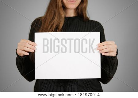 Girl Holding White A4 Blank Paper. Leaflet Presentation. Pamphlet Hold Hands. Woman Show Clear Offse