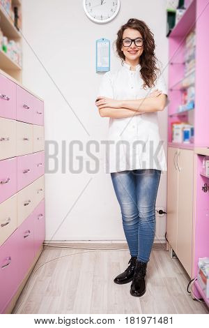 Pharmacist standing at her work place. Healthcare business