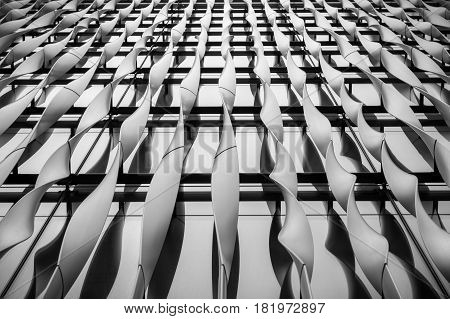 London UK - March 29 2017: Abstract detail of the aluminium fins decorating the front facade of The Monument building at the City of London