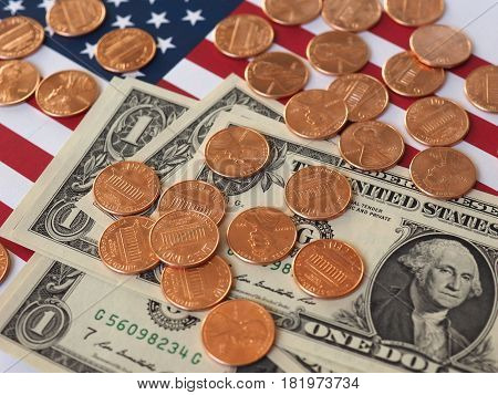 Dollar Notes And Coins And Flag Of The United States