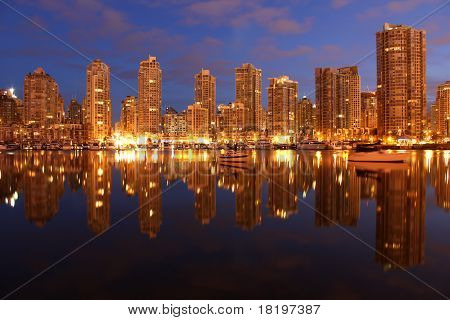 Yaletown condominiums at morning twilight on the edge of False Creek in downtown Vancouver. British Columbia, Canada. poster