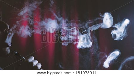 Vaping Electronic Cigarette Device Or E Cig By A Young Man