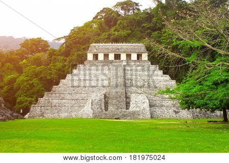 Temple of the Inscriptions - mesoamerican stepped pyramid structure at the pre-Columbian Maya civilization, Palenque, Chiapas, Mexico. UNESCO world heritage site