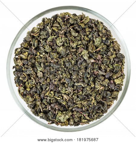 Green oolong tea in glass bowl isolated on white background with clipping path