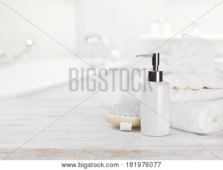 Soap dispencer towels massager and wisp of bast over blur
