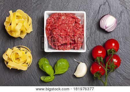 ingredients of a sauce bolognaise on slate
