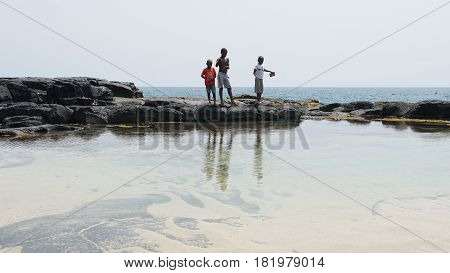 BOCA DE INFERNO, SAO TOME AND PRINCIPE - JANUARY 29, 2017: Fishing Kids on Boca de Inferno on January 29, 2017 in Sao Tome and Principe, Africa
