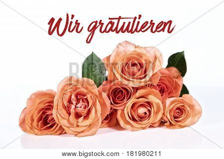Bouquet of roses with german text which means we congratulate white background