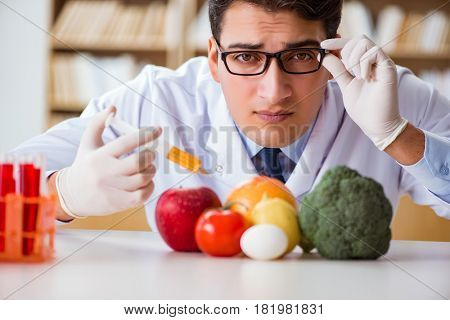 Man doctor checking the fruits and vegetables