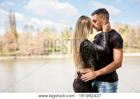 Happy inlove couple in the park taking a walk