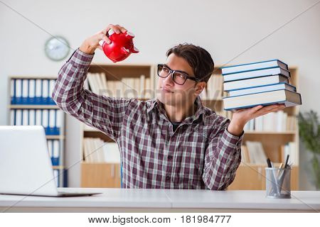Student breaking piggybank to pay for tuition fees