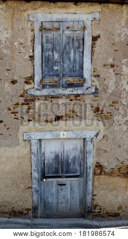 Delapidated door and shutters in old French house