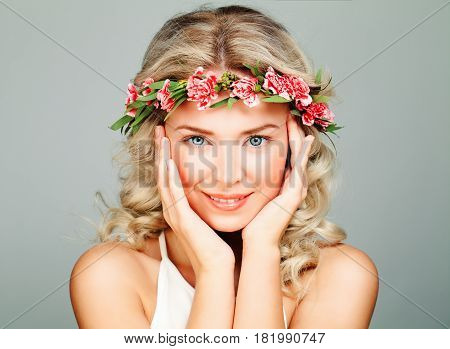Smiling Spa Model Woman with Healty Clean Skin Blonde Curly and Flower Wreath. Antiaging and Cosmetology Background