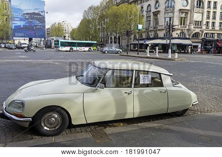 PARIS FRANCE - APRIL 1 2017: The legendary car Citroën DS on the Paris street. On the windows - the announcement of the sale.