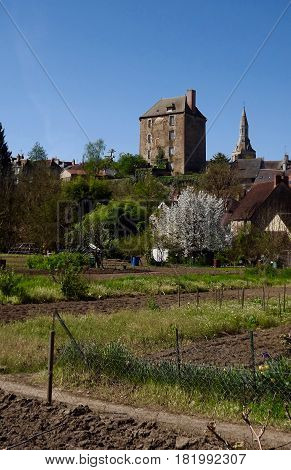 Vegetable allotments and buildings in rural central France