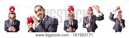 Businessman with piggybank on white