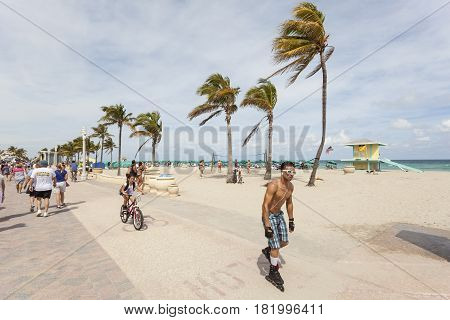 Hollywood Fl USA - March 13 2017: Inline skater and biker at the Hollywood beach broadwalk. Florida United States