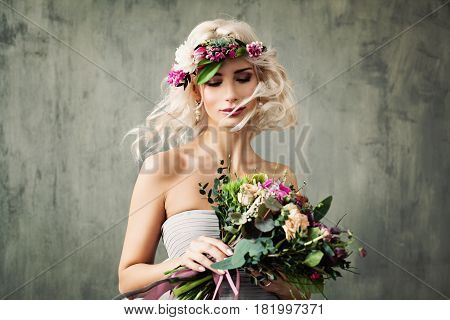 Nice Woman with Summer Flower Wreath. Blonde Beauty with Long Permed Curly Hair