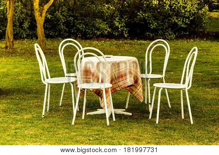 Vintage Looking Chairs And Round Table In Park