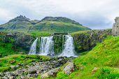 View of the Kirkjufellsfoss waterfalls in the Snaefellsnes peninsula west Iceland poster