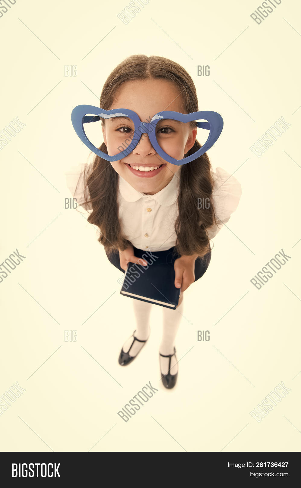 4e1e6cde11f6e Girl Cute Big Heart Shaped Glasses Isolated White Background. Child Girl  School Uniform Clothes Hold