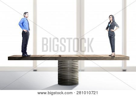 Asian Businessman And Businesswoman Standing On Balancer. Equality Gender Concept