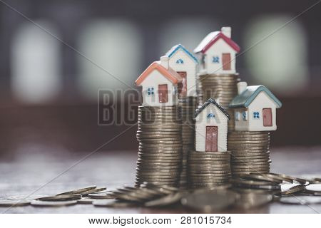 Mini House On Stack Of Coins,money And House,  Mortgage, Savings Money For Buy House And Loan To Bus