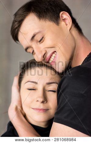 Portrait Of Young Loving Caucasian Couple. Young Happy Couple In Love Embracing On Studio Background