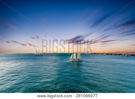 Schooner Under Sails Sailing Across A Bay Under Beautiful Skies