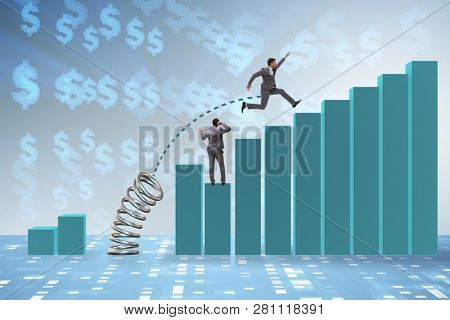 Businessman outperforming his competition jumping over