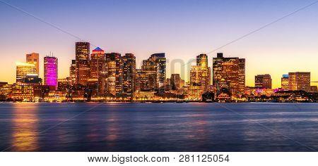 Night Cityscape Photo For Boston City Skyline With Sunset In Boston Harbor, Massachusetts, Usa, Unit